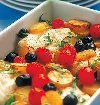 Ricciola al forno con patate, olive e pinoli